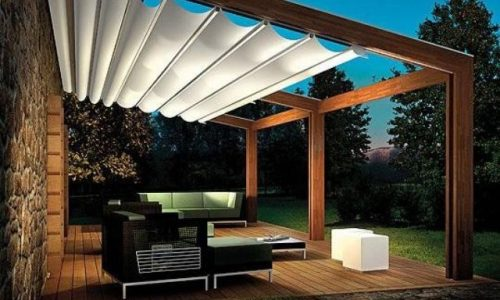 02-pergola-built-to-the-back-of-the-house-with-a-fabric-ceiling-cover